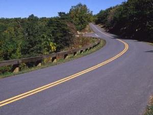 image of the current guardrail on a curve at mile marker 229 of the Parkway
