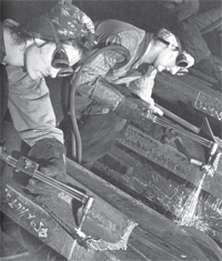 black and white photo of women welding