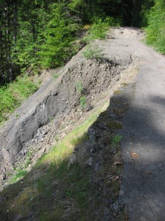 Photo of existing Boulder Creek Trail showing damaged section with serious erosion.