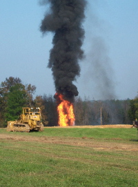 Photo of the wellhead fire during the blowout of the Howard/White Unit No. 1 Oil Well.