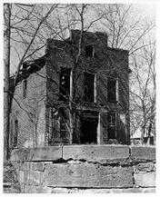 Black and White image of Jarboe store taken in 1963.   Building windows and doors are missing.