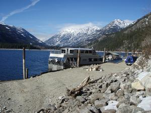 This photo shows the Lady Express, one of two public ferries serving Lake Chelan including the community of Stehekin.  The vessel is moored alongside the winter barge landing and public boat ramp.  The ferries dock in this area in winter during low lake levels.  These wintertime mooring conditions do not enable universal access for mobility-impaired persons.