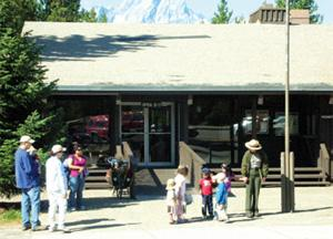 photo with visitors and ranger in front of the Visitor Center