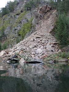 Photo taken shortly after the landslide.  This image shows a barge landing, dock and pickup truck that were destroyed by the slide.