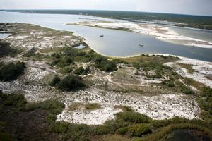 Fort Mcree at Perdido Key area in foreground, Big Lagoon and Robertson Island in background.  2 boats on the water.
