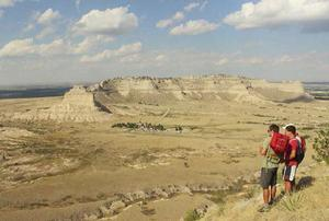 Two men overlooking the Scotts Bluff National Monument