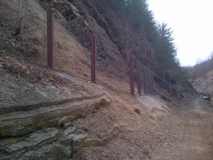 Photograph of high energy fence that was installed to prevent loose rock from injuring hikers and bikers entering and existing the Paw Paw Tunnel.