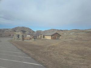Photo of the Abandoned Visitor Center with the Badlands terrain in the background.