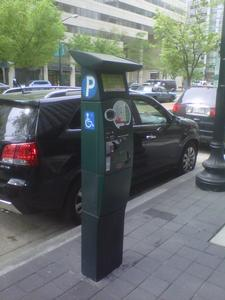 Example of multi-space parking meter currently used in surrounding area.