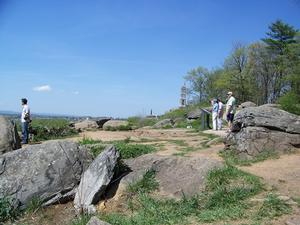 Photograph showing visitor impacts and soil erosion on the summit of Little Round Top.