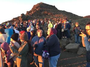 crowds at the summit during sunrise hours