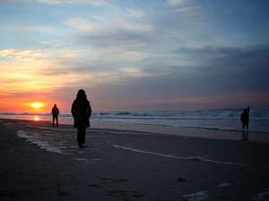 People enjoy sunset views in the designated wilderness of Fire Island National Seashore.