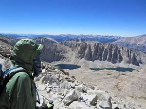 Hiker on the trail to Mount Whitney, overlooking the Guitar Lake area.