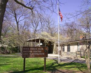 Photo of the Rock Creek Park Nature Center and Planetarium in spring.
