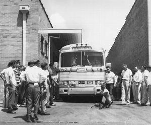 Photo of one unidentified white man sits in front of Grayhound bus to prevent it from leaving the station with load of Freedom Riders, AP Photo.