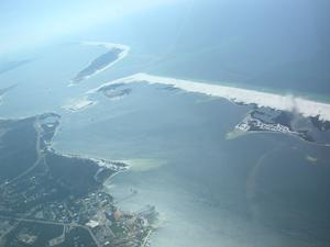 aerial image looking southeast, showing the sands and surrounding waters of Perdido Key, Big Lagoon and the western end of Santa Rosa Island.