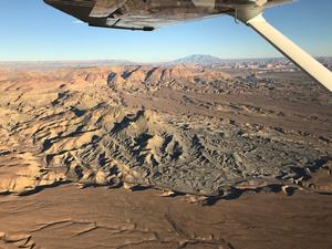 Photo of landscape taken from an airplane within Glen Canyon National Recreation Area with Navajo Mountain in the background.