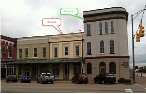 Urban street view of the Selma Interpretive Center building and 4 Broad Street building.