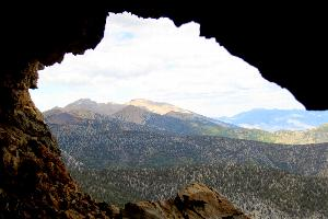 View of Wheeler Peak from Wild Goose Cave, with cave entrance framing the high peaks.
